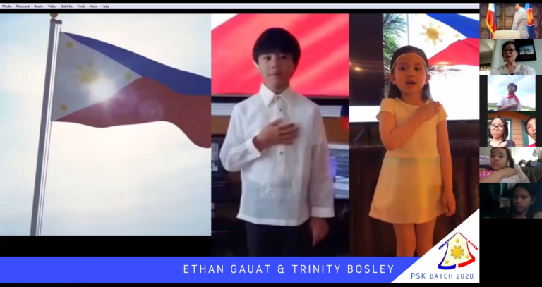 PSK students Ethan Gauat and Trinity Bosley lead the singing of the Philippine National Anthem at the closing of the 22nd Paaralan sa Konsulado. (Photo by PCGNY)